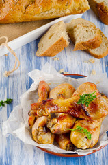 Roasted chicken legs with a fresh bread