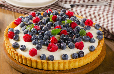 Cheese Cake with  fresh raspberries and blueberries.
