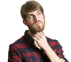 Young bearded man thinking