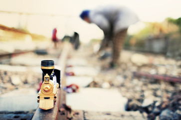 Train toy model on workers background. Shallow depth of field co