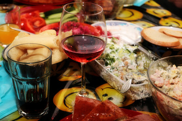 glass of red wine and food on the table