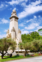 Eastern side of the Cervantes monument on the Square of Spain (P