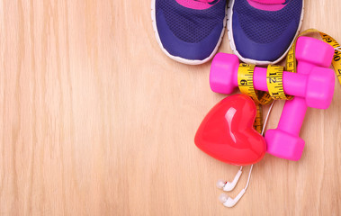 Sport Equipment for Cardio. Sneakers, dumbbells, measuring tape