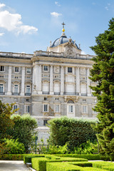 View of the Royal Palace of Madrid from garden on the blue sky b