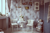 Retro interior with chairs and cups of tea.