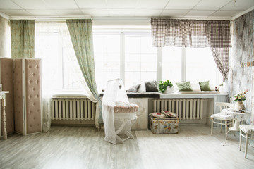 Interior in retro style bright room with a cot and large windows