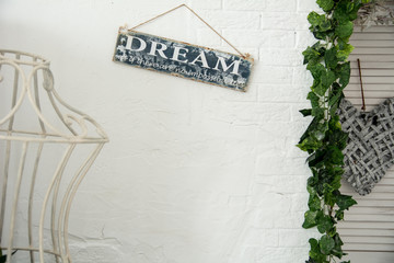 Background of a white wall in the room with a sign to dream