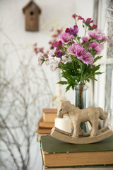 Designer composition with artificial flowers