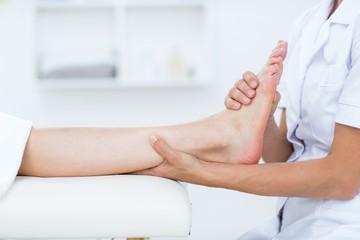Physiotherapist doing foot massage