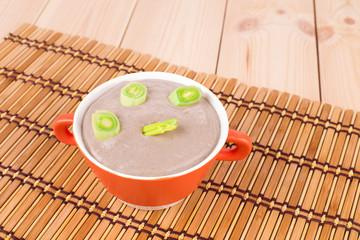 Creamy mushroom soup with green onion.