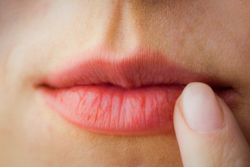 Woman pointing to her lips