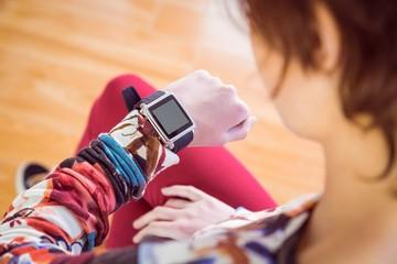 Slim woman looking at her smart watch