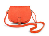Red female leather bag falls in the air