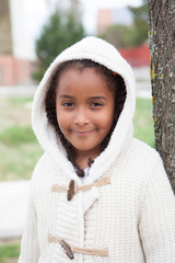 Pretty african girl with winter clothes