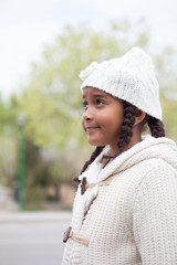 Pretty african girl with winter clothes outdoors