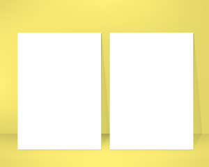 Empty brochure design template leaned against a wall. Pair of