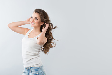 Brunette girl with fluttering hair with wind