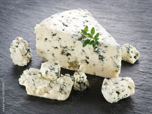 Slices of Danish Blue cheese. - 81910408