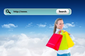 Composite image of smiling blonde holding shopping bags