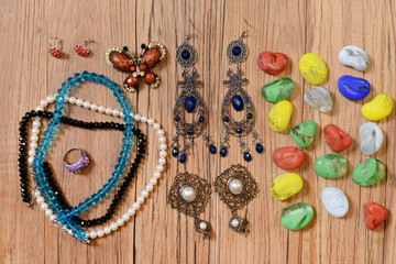 Necklaces, earrings and colored glass