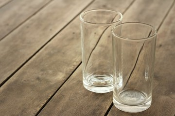 glasses on a background of brown table