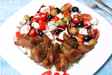 fried meat and vegetable salad