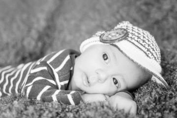 cute newborn baby in knitted cap