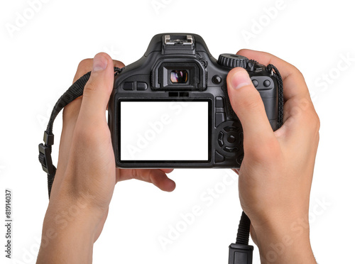 DSLR camera in hand isolated - 81914037
