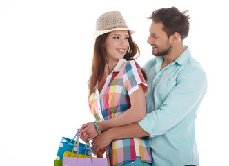 Young couple with packages on a white background