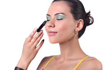 Applying make-up by make-up artist