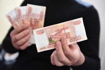 the Russian ruble (Российский рубль)