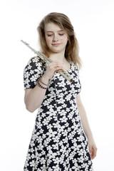 teenage girl in dress holds flute in studio