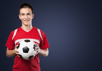 Soccer. Young soccer player with ball in front of white