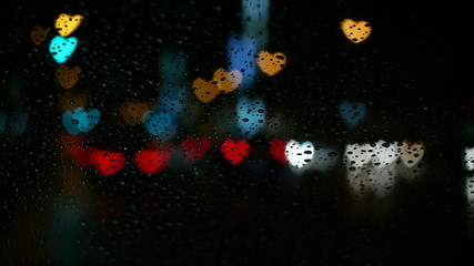 Dancing hearts in city illumination