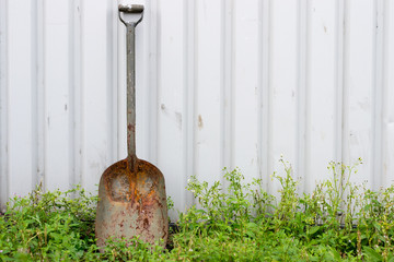 Workmans Spade Leaning Against a Corrugated Wall
