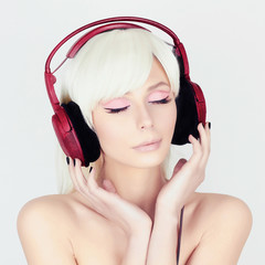 beauty young Woman listening music on headphones