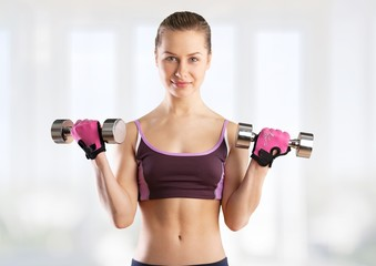Trainer. Picture of beautiful sporty woman with dumbbells