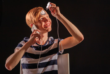 Young man with body-art and mobile phone