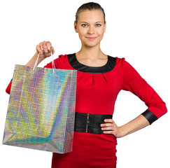 Woman with smile showing shopping bag