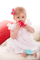 Beauty baby girl playing with cup toy