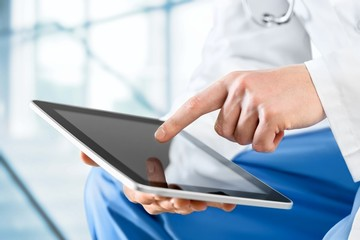 User. Close-shot of male hands holding a tablet in hands