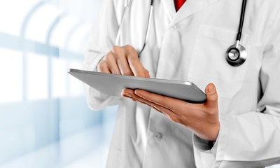 Using. Doctor in hospital using a digital tablet