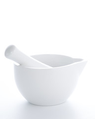 white porcelain mortar and pestle set isolated