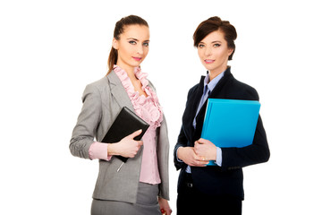 Businesswomans holding their notes.