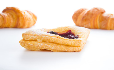 Delicious Cherry puff pastry with croissants isolated on white