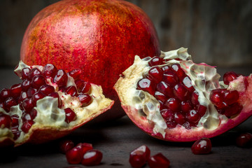 Red juicy pomegranate, whole and broken