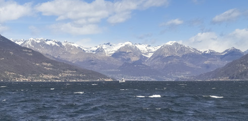 Lake of Como with snow-capped mountains.
