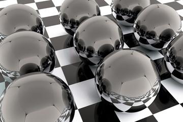 Black reflective spheres on checkered floor