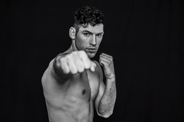 Man punching on a black background