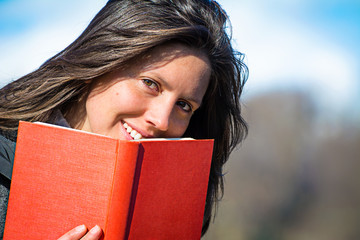 portrait of a girl with a red book in her hands